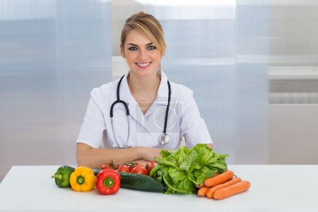 Female Dietician With Vegetables