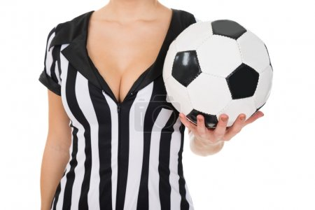 Female Referee Holding Football
