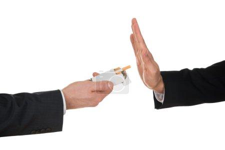 Businessman Refusing Cigarette