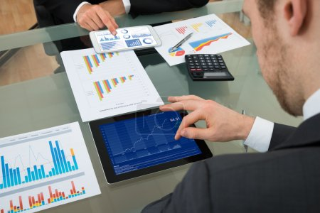 Photo for Two Businessmen Analyzing Graph On Digital Tablet - Royalty Free Image