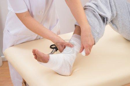 Woman Tying Bandage