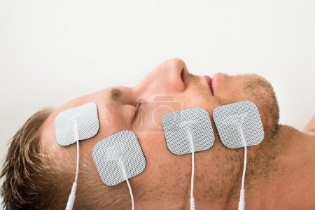 Man With Electrodes On Face