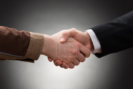 Photo for Worker And Businessman Shaking Hands close up - Royalty Free Image