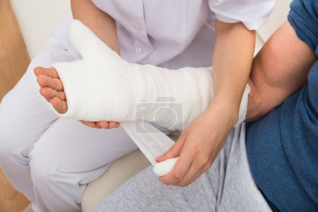 Nurse Dressing Patient Hand