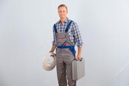Photo for Young Happy Electrician Holding Cables And Toolbox - Royalty Free Image