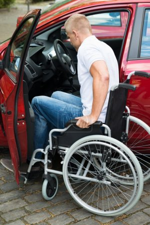 Handicapped Man Boarding In Car
