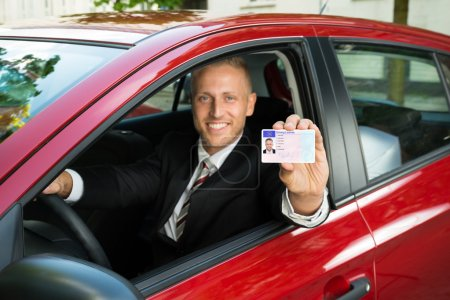 Businessman Showing Driving License