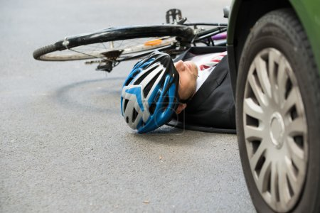 Unconscious Male Cyclist on Road