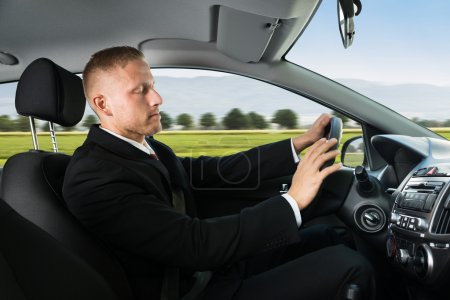Businessman Sleeping and Driving Car