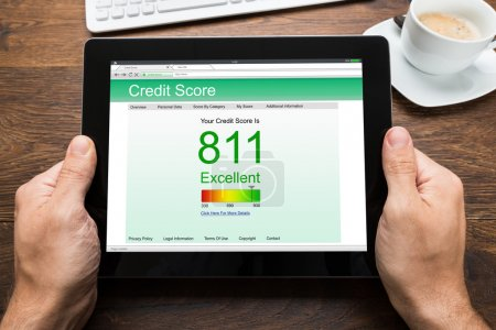 Person Hands Showing Credit Score