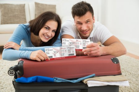 Happy Couple Showing Boarding Pass