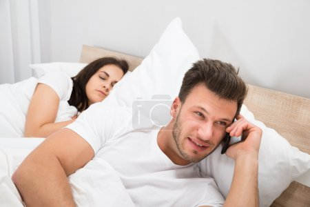 Man Talking Privately On Cellphone