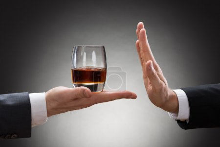 Businessman Hand Reject Glass Of Whisky
