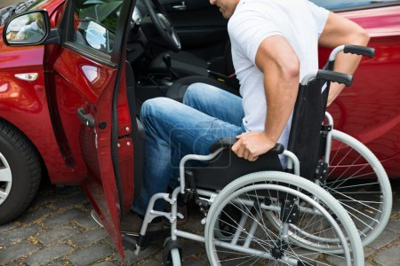 Disabled Man Boarding In Car