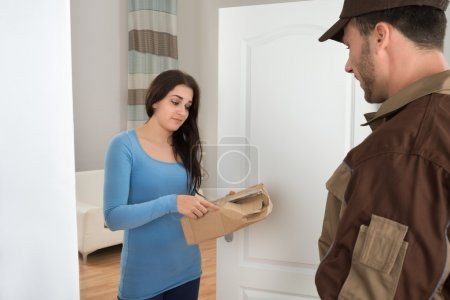 Woman Holding Damaged Package