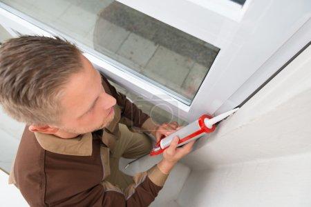 Man Applying Silicone Sealant