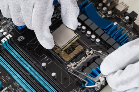 Photo for Close-up Of Person Hands Installing Central Processor In Motherboard - Royalty Free Image