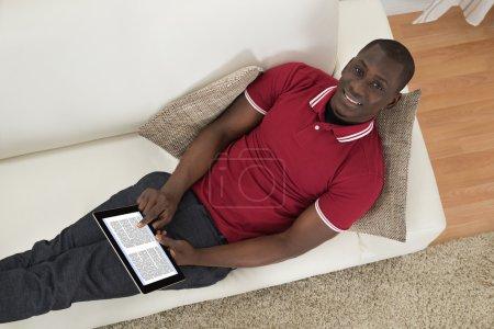 Man Holding E-book
