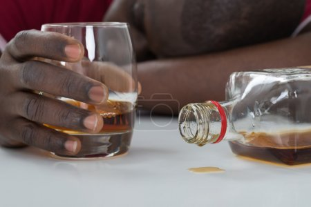 Photo for Close-up Of Man Hand Holding Glass Of Whisky - Royalty Free Image