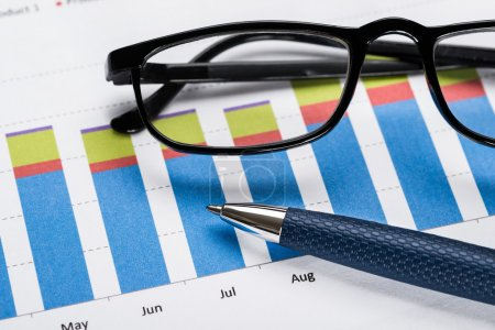 Financial Graph With Eyeglasses