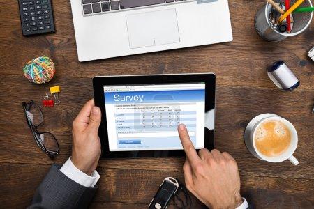 Businessman Filling Online Survey Form