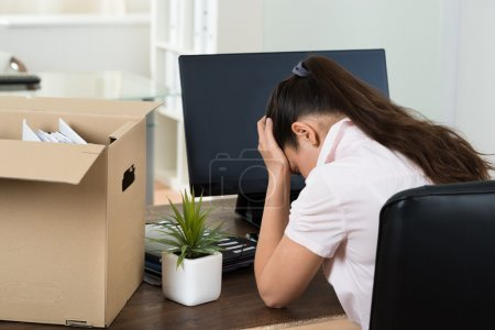 Upset Businesswoman At Desk