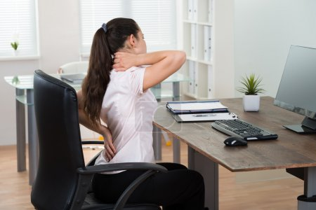Businesswoman Having Backpain