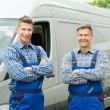 Two Happy Repairmen In Overalls With Arms Crossed ...