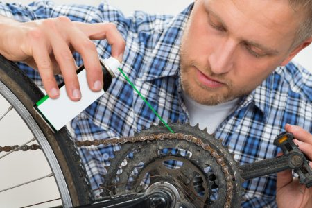 Man Oiling Bicycle Chain
