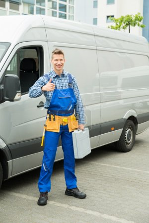 Repairman With Tools And Toolbox