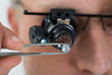 Person Looking At Diamond With  Loupe