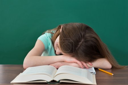 Student Sleeping At Desk