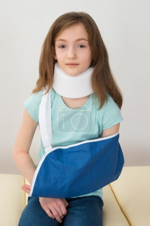 Girl Wearing Neck Brace And Arm Sling