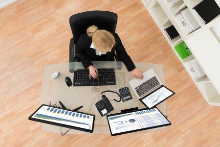 Businesswoman Analyzing Financial Statistics