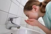 Girl Washing Mouth