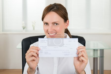 Businesswoman Showing Cheque