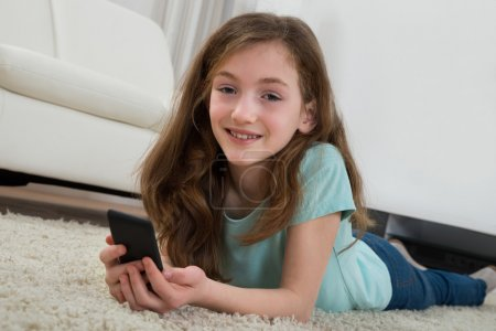 Girl With Mobile Phone In Living Room