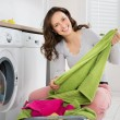 Young Happy Woman Laundering Clothes In Electronic...