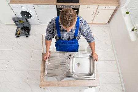 Plumber Fixing Stainless Steel Sink