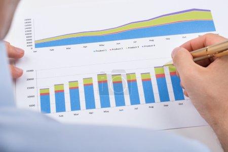 Businessperson Analyzing Graphs