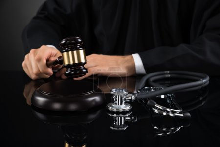 Judge Hitting Gavel With Stethoscope