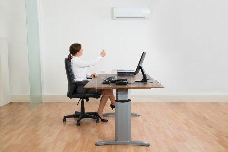 Businesswoman Using Air Conditioner