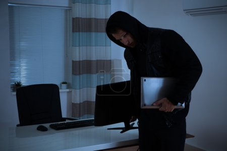Thief Stealing Computer And Laptop