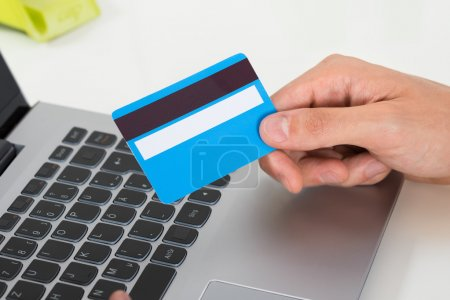 Person Hands With Credit Card