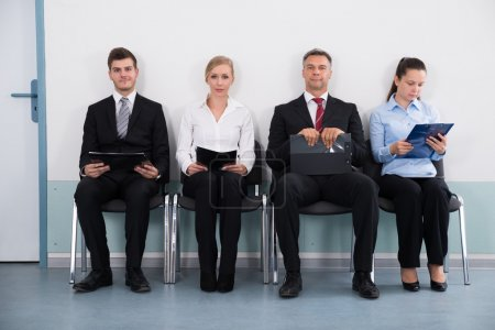 Businesspeople Sitting On Chair For Giving Interview