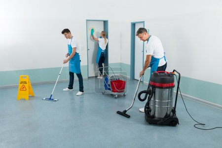 Janitors Cleaning Corridor