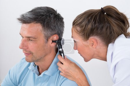 Doctor Examining Patient's Ear