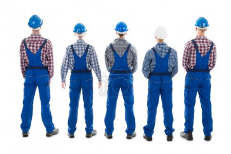 Male Carpenters Standing In Row