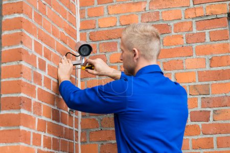 Technician Installing Camera