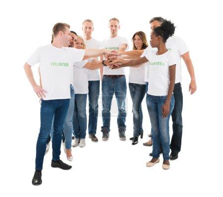 Multiethnic Volunteers Stacking Hands